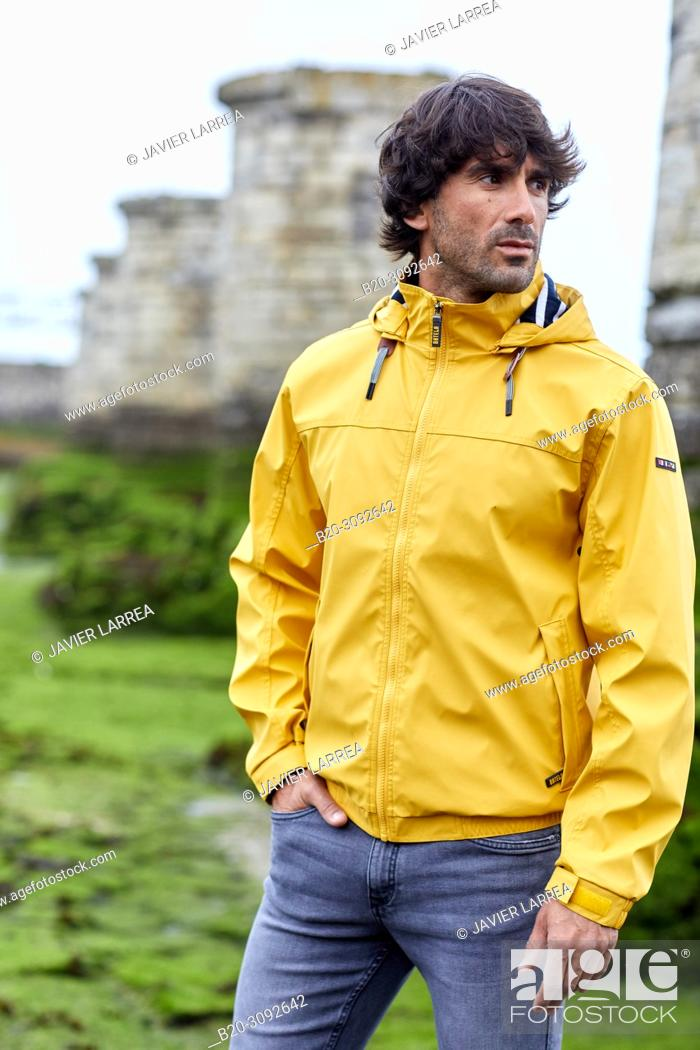 Stock Photo: Man with raincoat, Adour river mouth, Anglet, Biarritz, Atlantic Pyrenees, France, Europe.