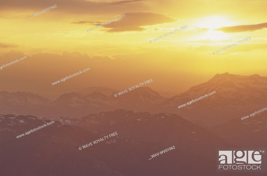 Stock Photo: Orange clouds over Coast Mountain Range at sunset, summer.