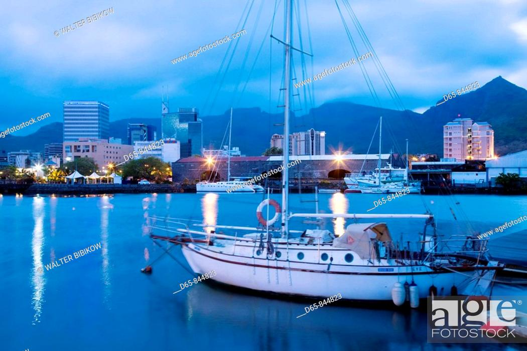Stock Photo: Port Louis, city view from harbor at dawn, Mauritius.