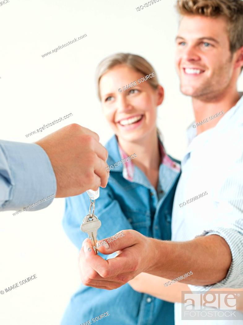 Stock Photo: Young couple being handed house keys.