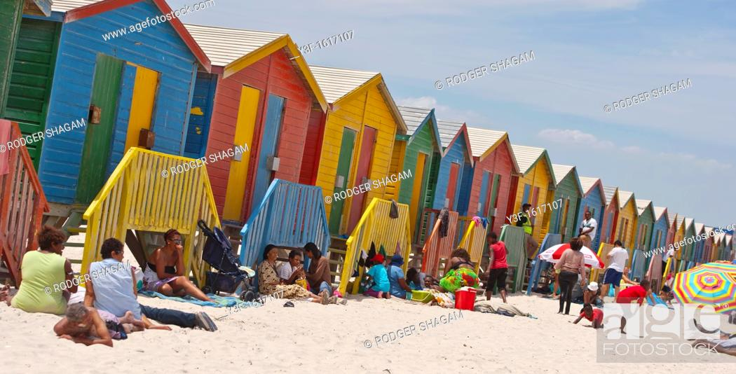 Stock Photo: Rows of wooden huts/bathing boxes/private changing room line the high water mark at Muizenberg Beach, Cape Town, South Africa.