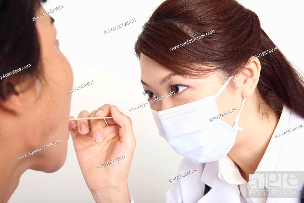 Stock Photo: Doctor examining.