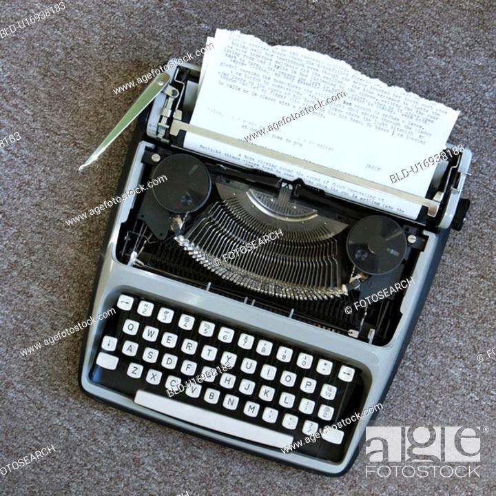 Stock Photo: Overview of typewriter with paper that has been typed on.