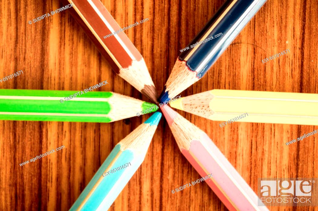 Stock Photo: Crayons pointing to center. Symbolical image central power meeting at a point. Close-up of a selection of Multi Colored pencils.