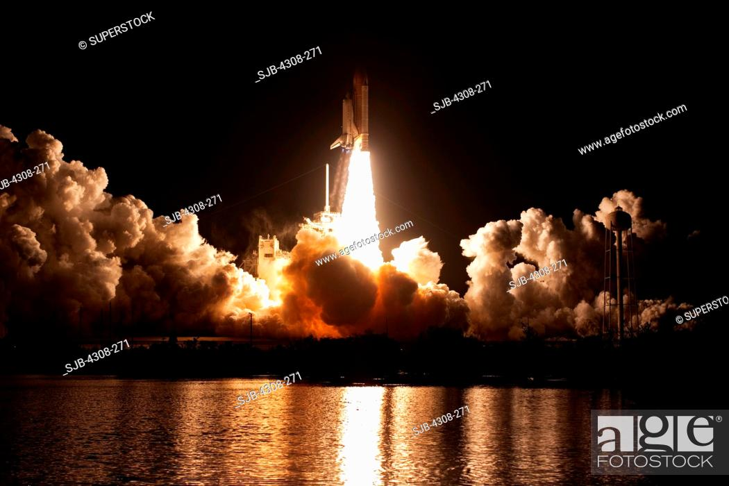Stock Photo: CAPE CANAVERAL, Fla. - Propelled by an estimated 7 million pounds of thrust from two solid rocket boosters and three main engines.