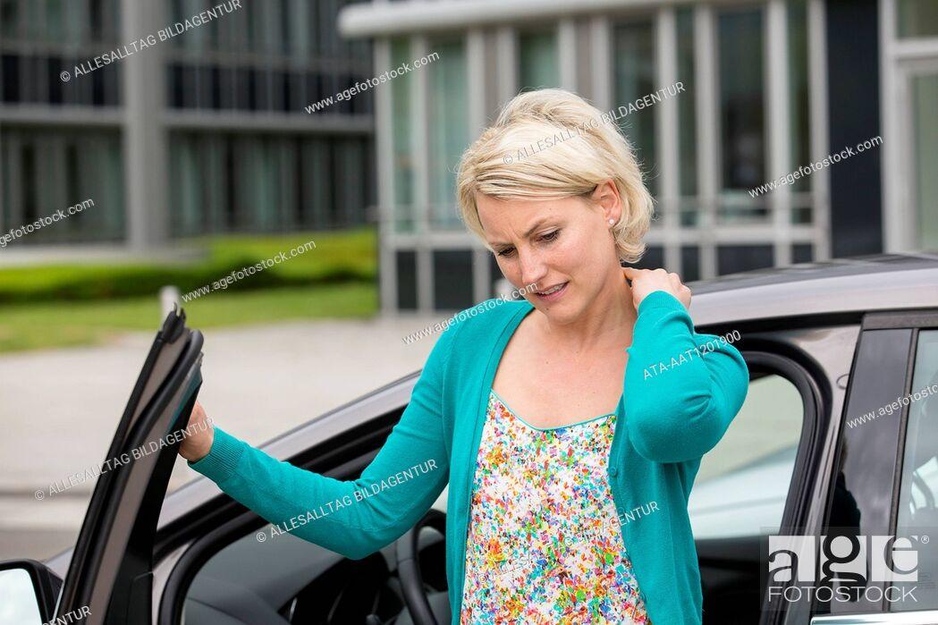 Stock Photo: Female car driver has neck pain.