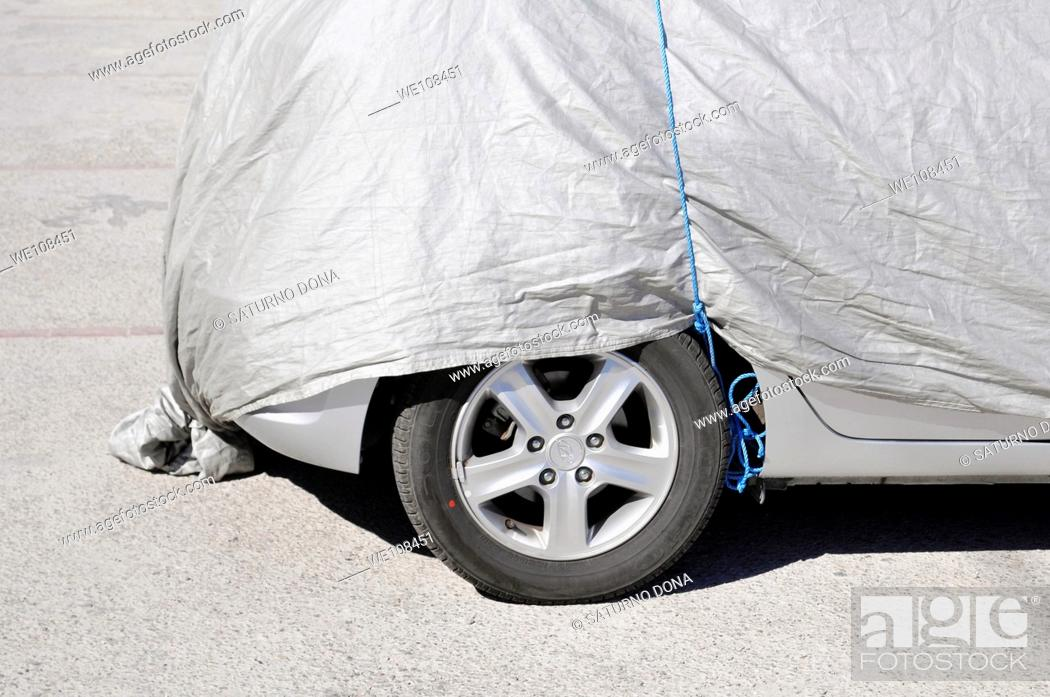 Stock Photo: car parked under cover.