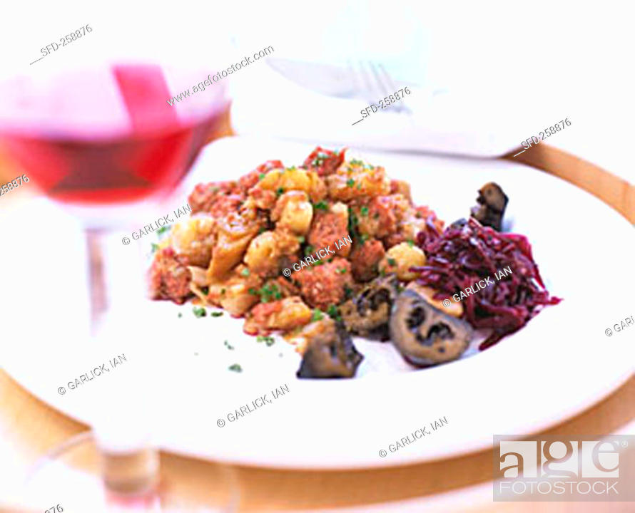 Stock Photo: Corned beef with diced potatoes, onions & red cabbage.