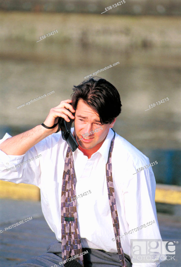 Stock Photo: Businessman talking on phone.