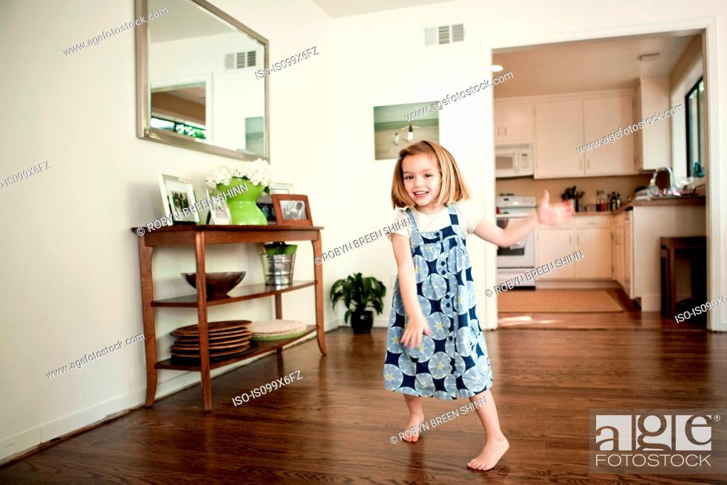 Stock Photo: Little girl dancing at home.