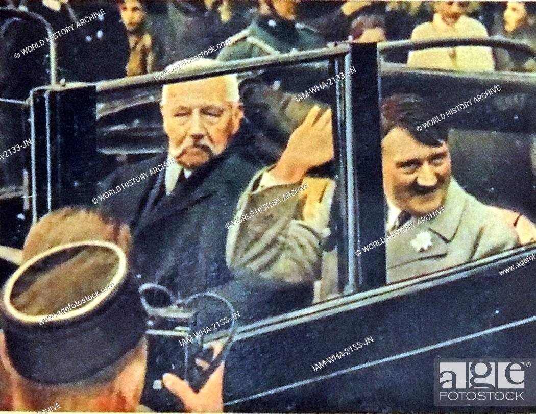 Stock Photo: President Paul Von Hindenburg and Adolf Hitler riding in a car after Hitler was appointed Chancellor in 1933.