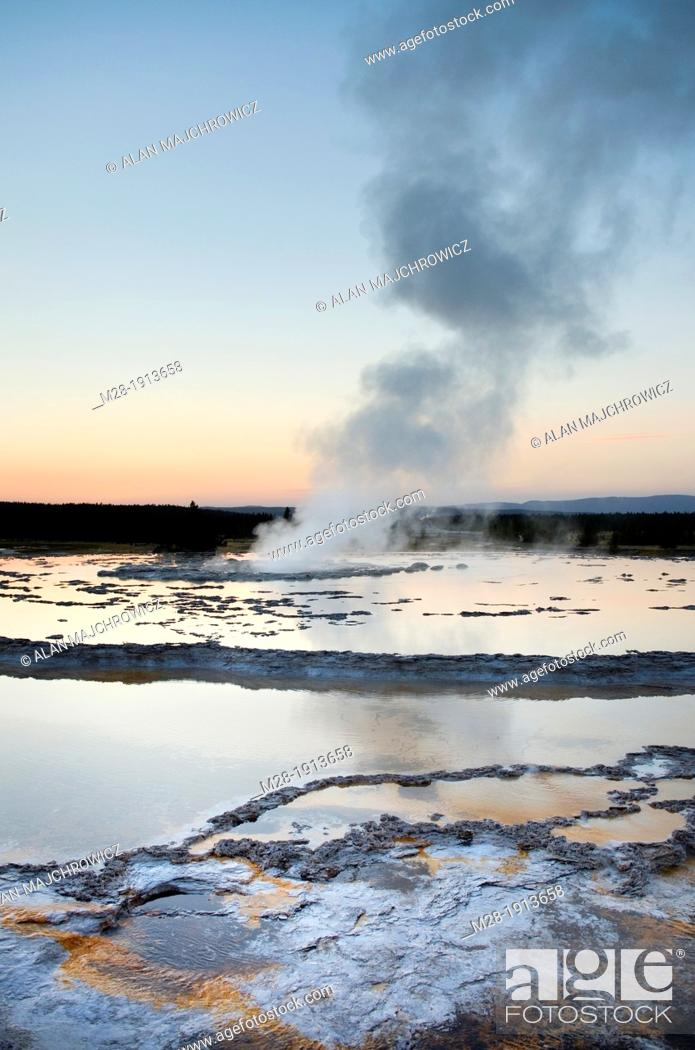 Stock Photo: Great Fountain Geyser at sunset, Yellowstone National Park.