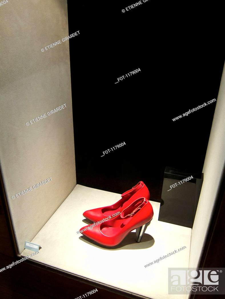 Stock Photo: Shoes on display at shop window.