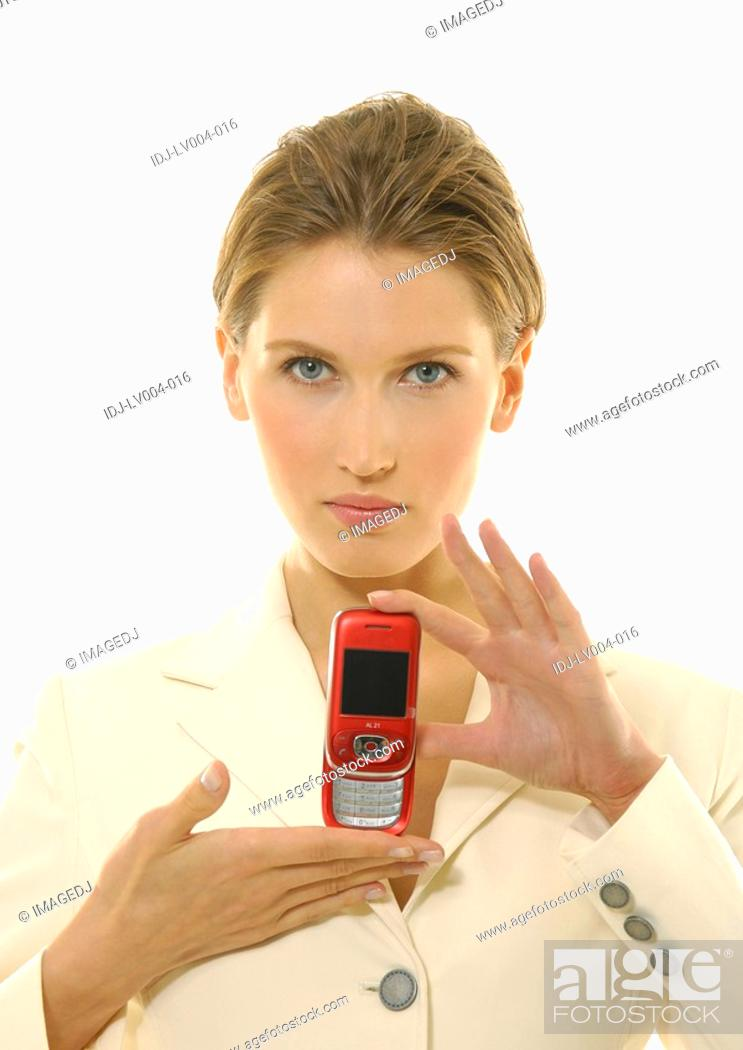 Stock Photo: Portrait of a businesswoman showing a mobile phone.