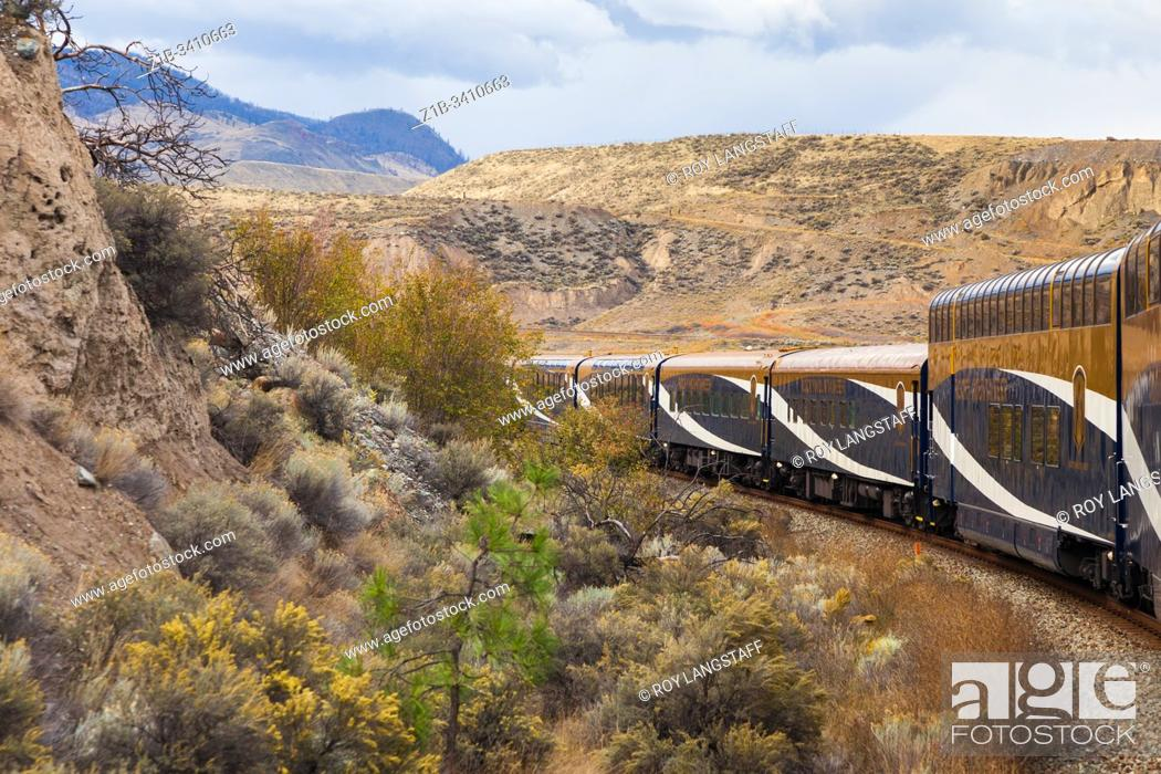 Stock Photo: The Rocky Mountaineer rounding a bend approaching Ashcroft in British Columbia Canada.