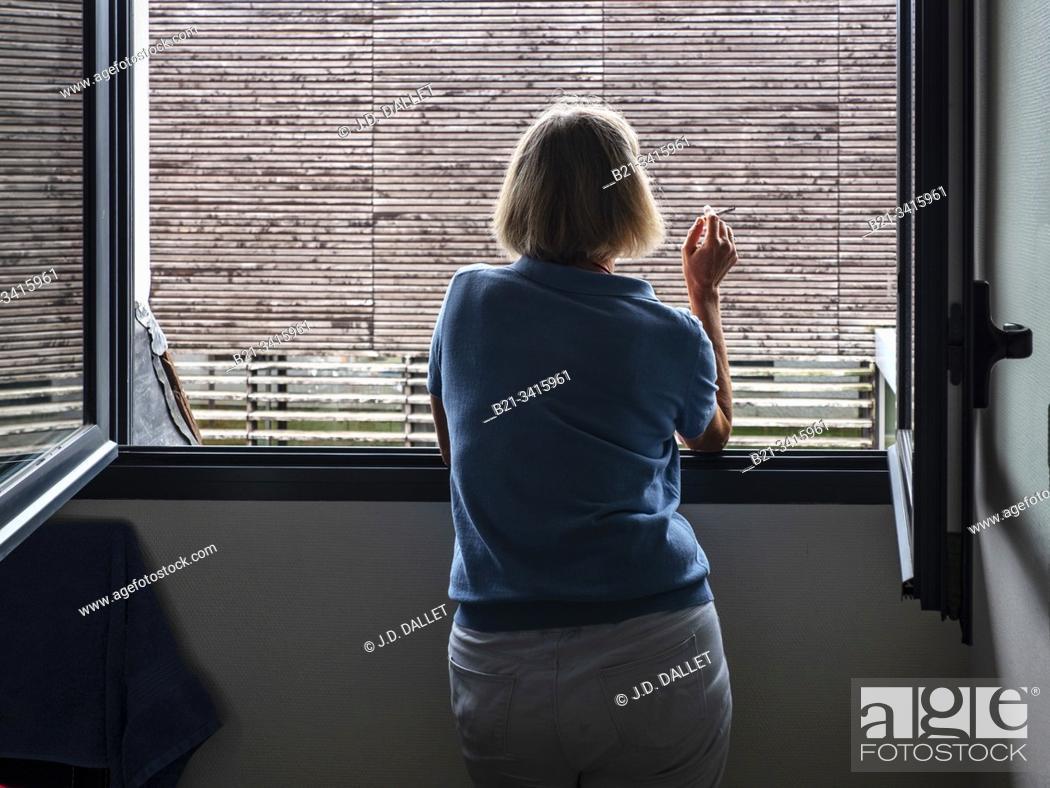 Stock Photo: Woman at window.