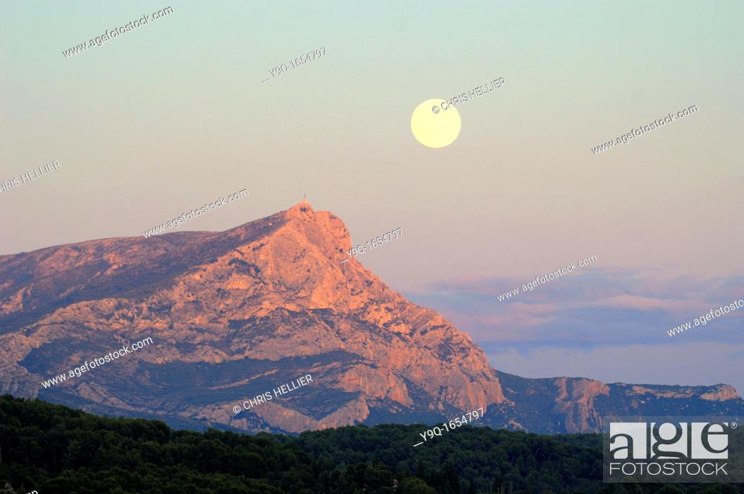 Stock Photo: Full Moon or Moon Rise over Montagne Sainte-Victoire or Mont Sainte-Victoire near Aix-en-Provence or Aix en Provence France.