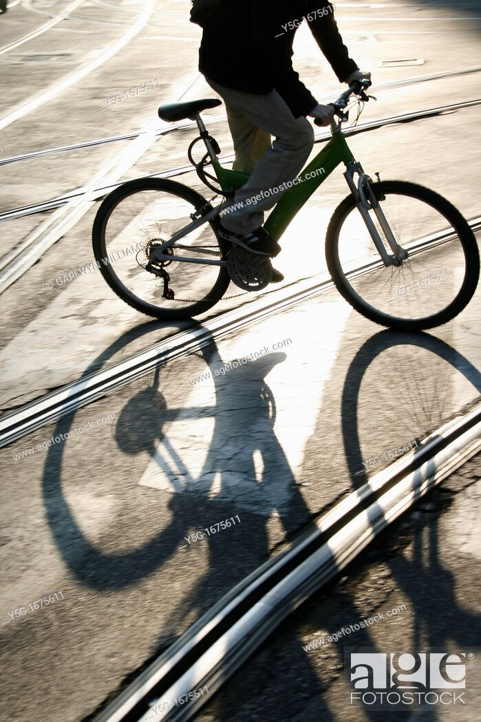 Stock Photo: man riding bike in city.