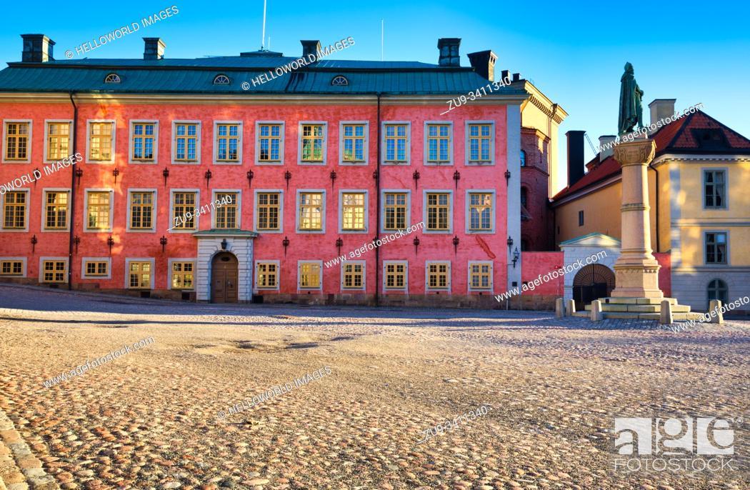Stock Photo: Colourful facade of Stenbock Palace at sunrise with statue of Birger Jarl, Birger Jarls Torg, Riddarholmen, Stockholm, Sweden.