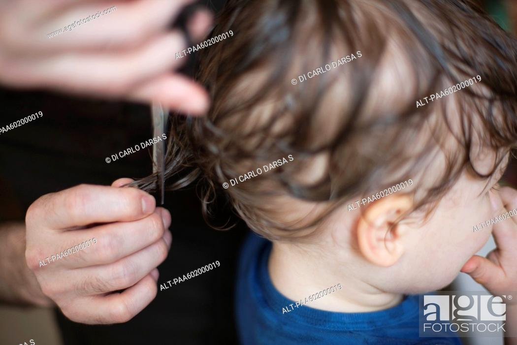 Stock Photo: Toddler getting a haircut, cropped.