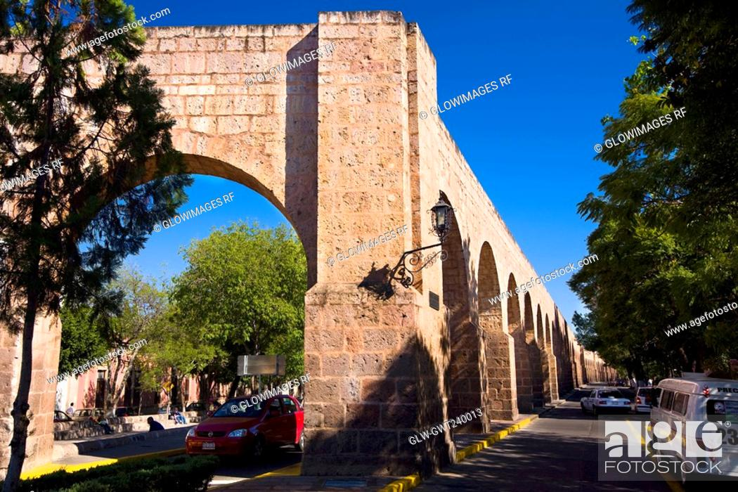 Stock Photo: Ruins of an aqueduct at the roadside, Morelia, Michoacan State, Mexico.