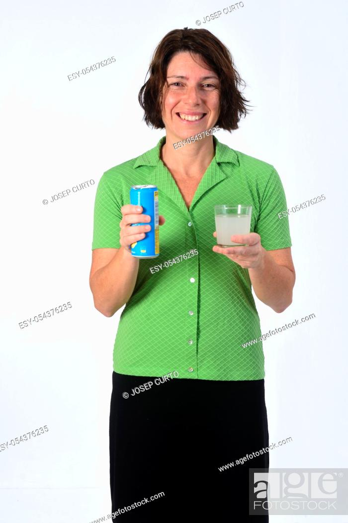 Stock Photo: woman with a glass of lemon soda on white background.
