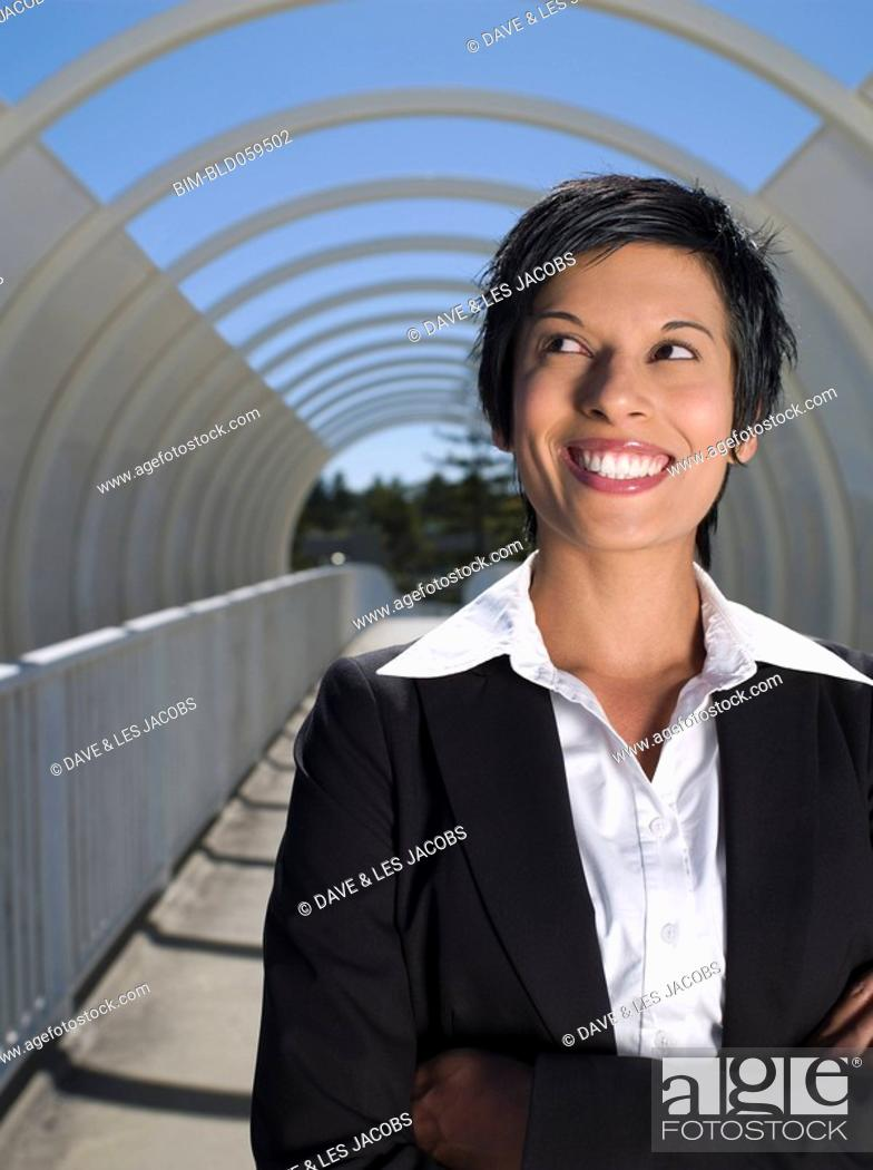 Stock Photo: Mixed Race businesswoman with arms crossed.