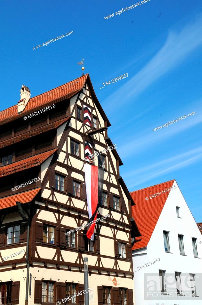 Stock Photo: The Siebendächerhaus in Memmingen with city flag hoisted, Bavaria, Germany.