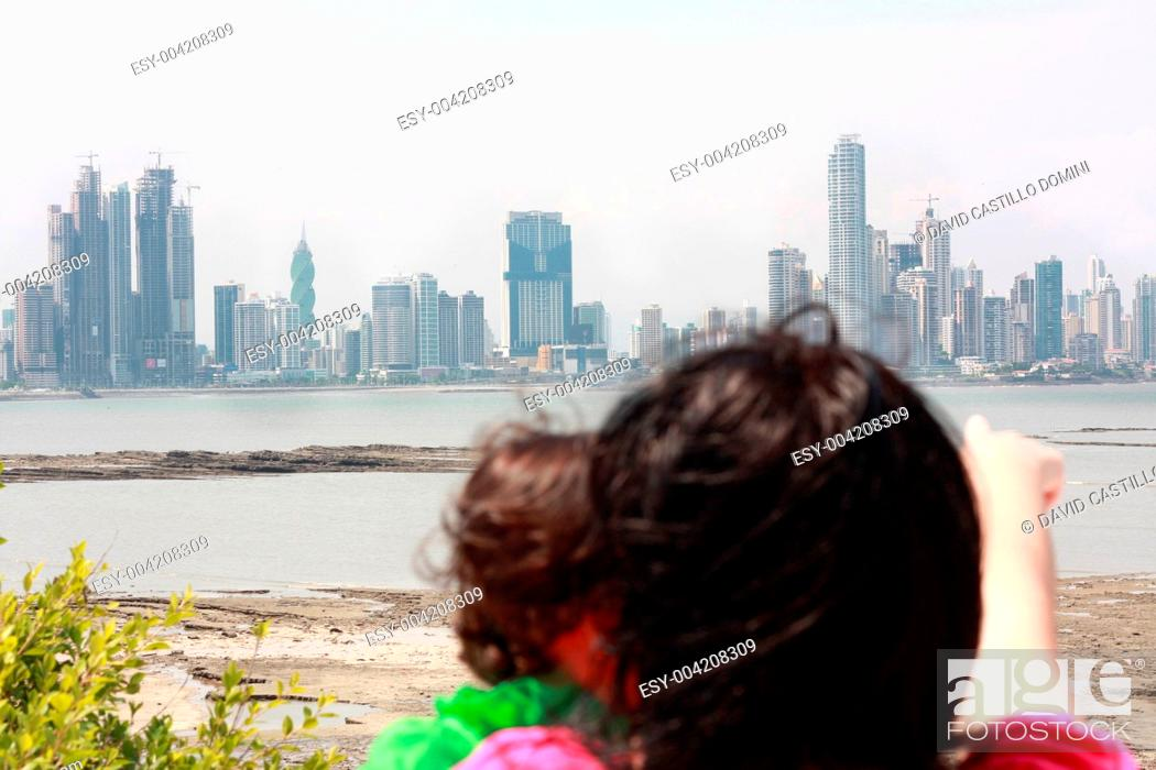 Stock Photo: Mother shows her daughter a beautiful view over the city.