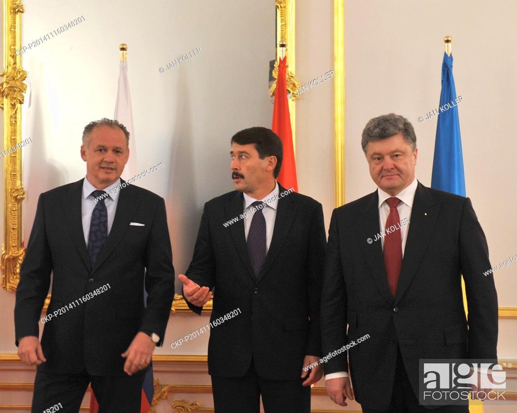 Stock Photo: From left Andrej Kiska, Slovakian President, Janos Ader, Hungarian President and Petro Poroshenko, President of Ukraine pictured during photographing at meeting.