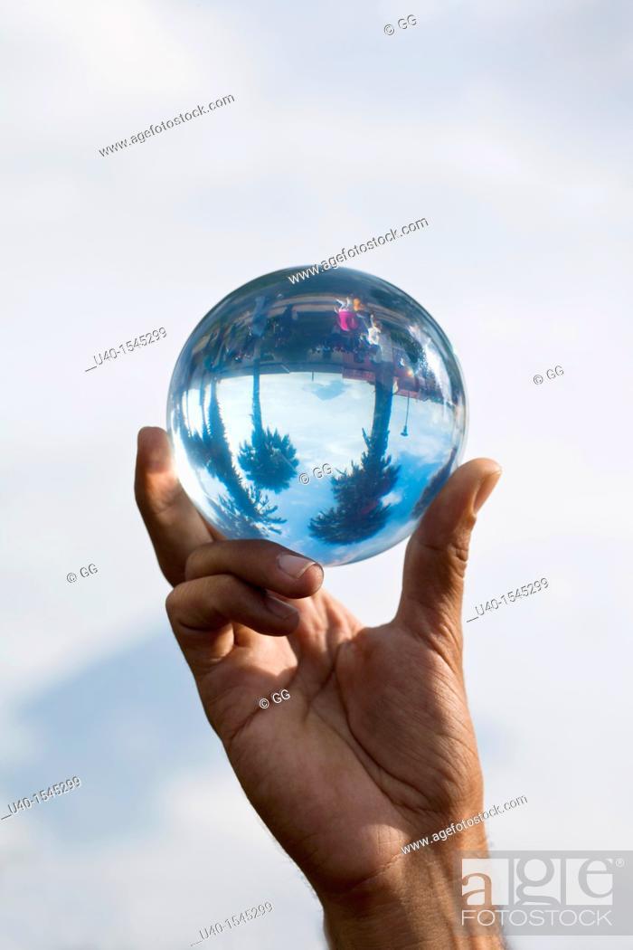 Stock Photo: Man holding crystal ball.