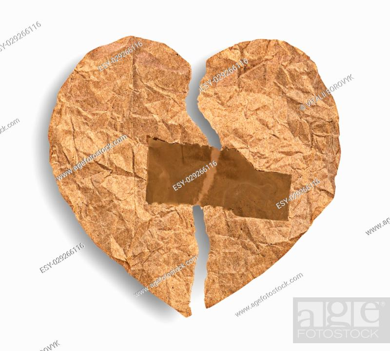 Stock Photo: Broken crumpled paper heart coupled with tape isolated on white background.
