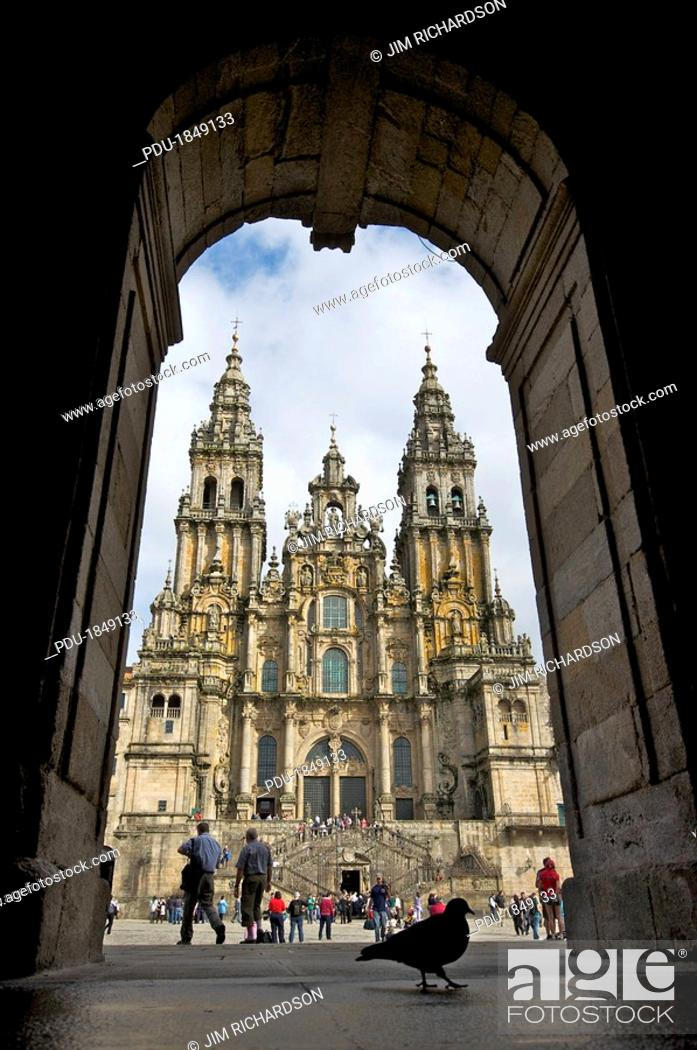 Stock Photo: Exterior view of a Gothic cathedral's facade through an archway.