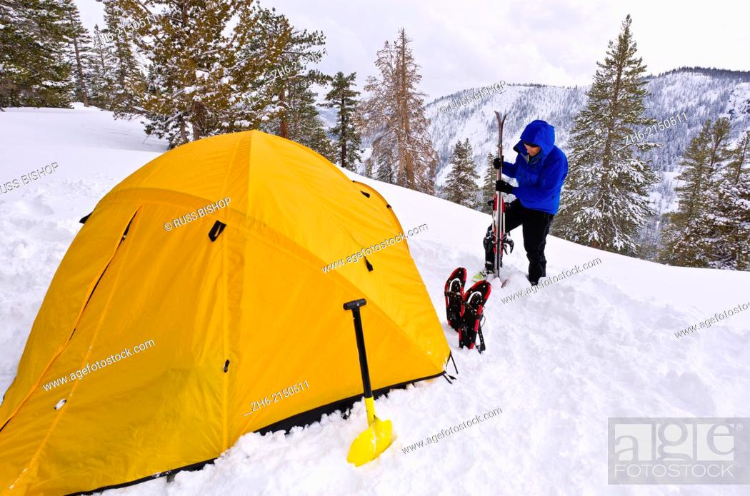 Stock Photo: Backcountry skier and yellow dome tent, Ansel Adams Wilderness, Sierra Nevada Mountains, California USA.