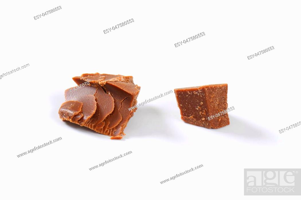 Stock Photo: pieces of milk chocolate on white background.