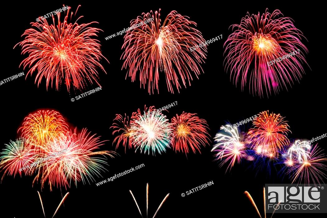 Stock Photo: colorful fireworks over dark sky background.