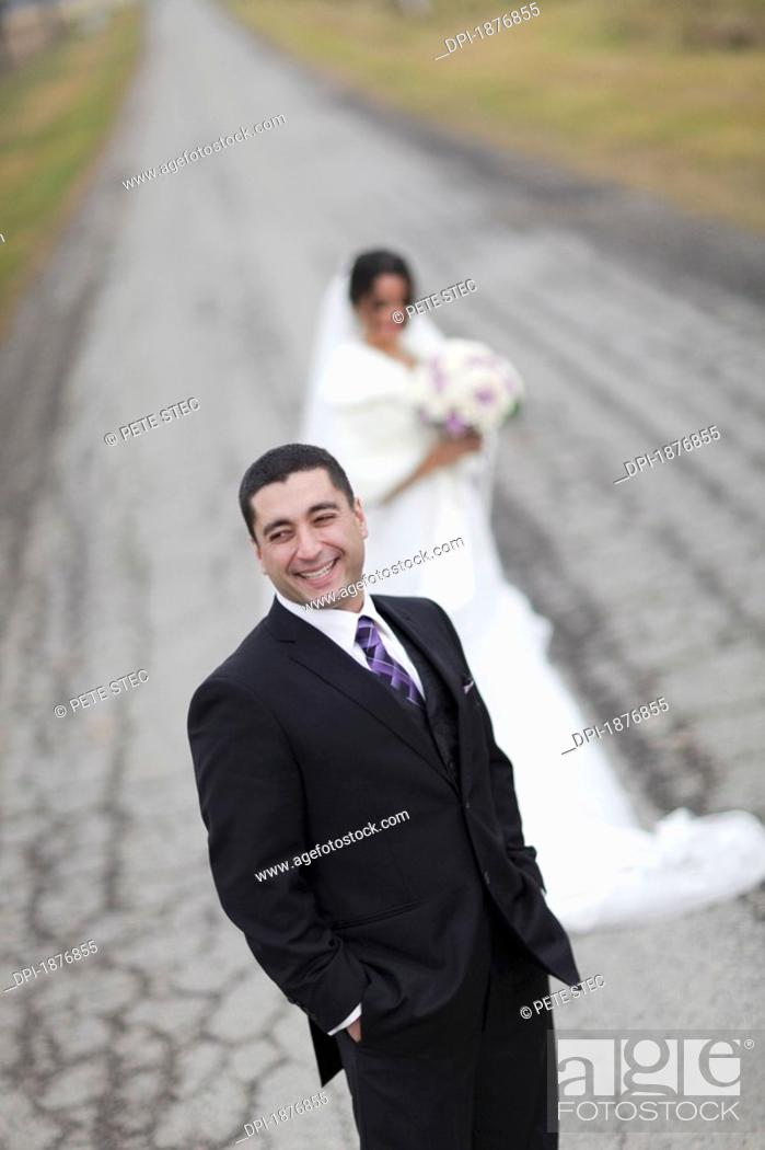 Stock Photo: ontario, canada, a bride and groom standing on a road.