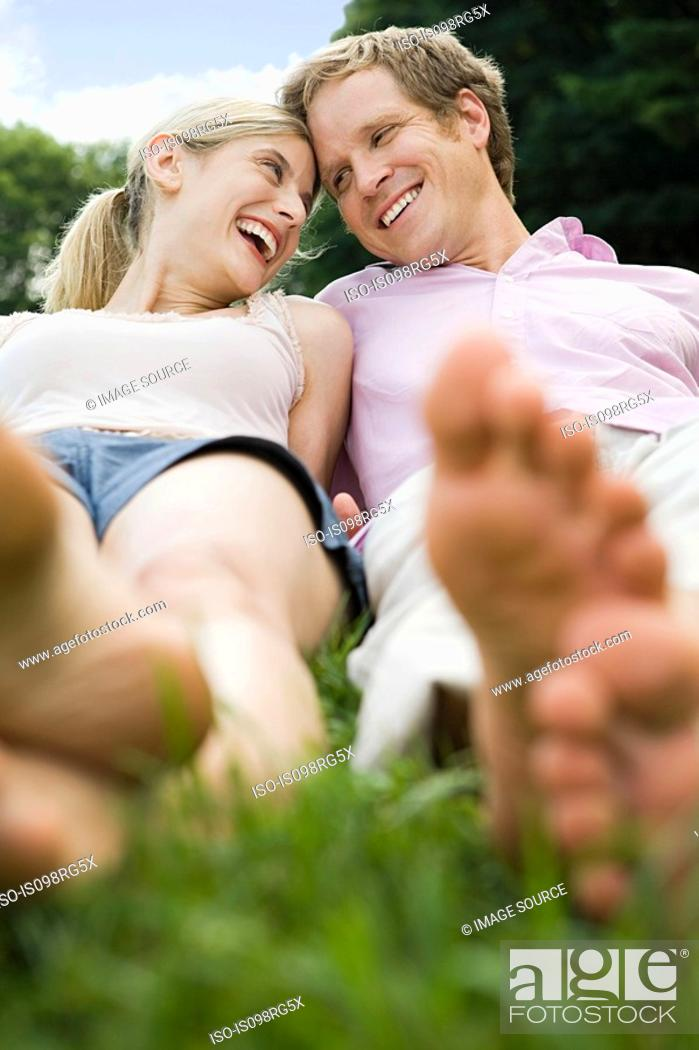 Stock Photo: Couple lying in a field.