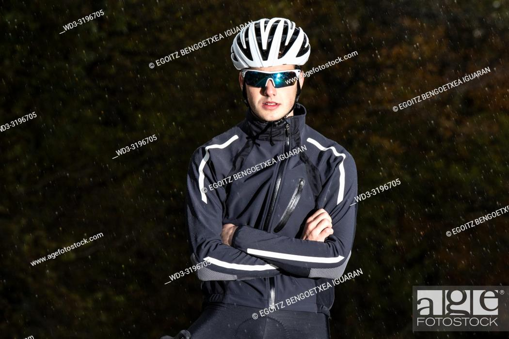 Stock Photo: young cyclist boy riding alone at the forest in autumn. Aralar Natural Park, Navarra, Spain.