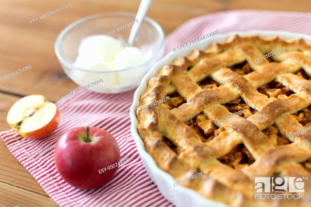 Stock Photo: apple pie with ice cream on wooden table.