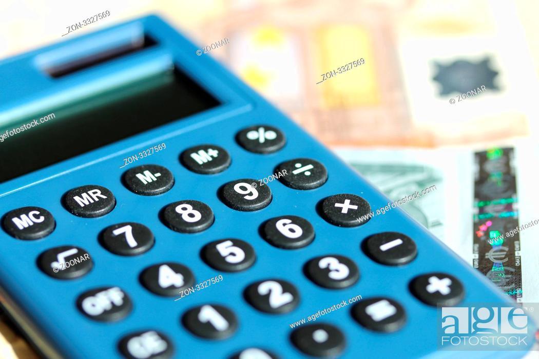 Stock Photo: Ein Taschenrechner mit Euroscheinen.