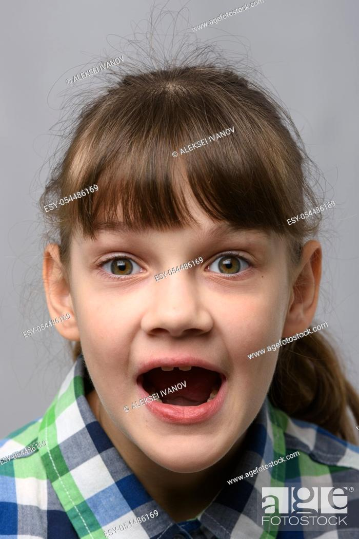 Stock Photo: Portrait of a genuinely surprised ten-year-old girl with closed eyes, European appearance, close-up.