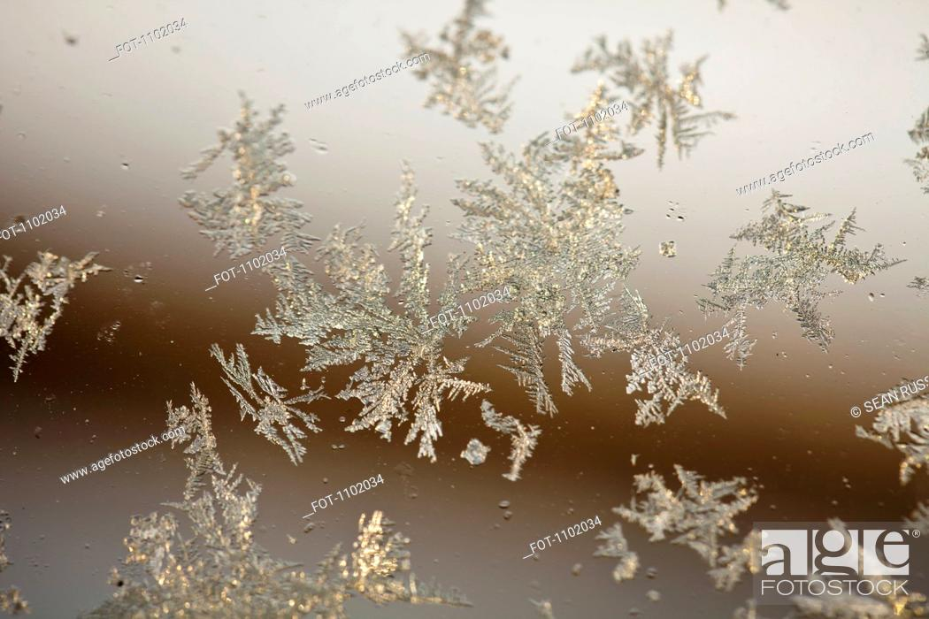 Stock Photo: Frost on a window.