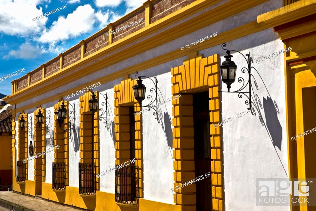 Stock Photo: Lanterns mounted on the wall of a building, San Cristobal De Las Casas, Chiapas, Mexico.