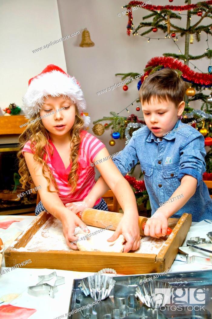 Stock Photo: Children making Christmas cake.
