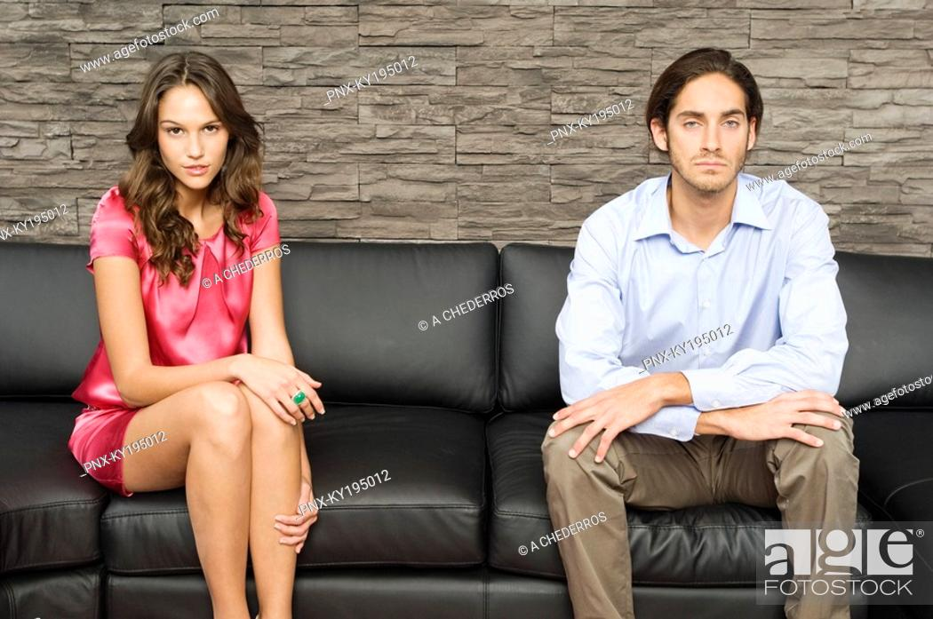 Stock Photo: Couple looking serious.