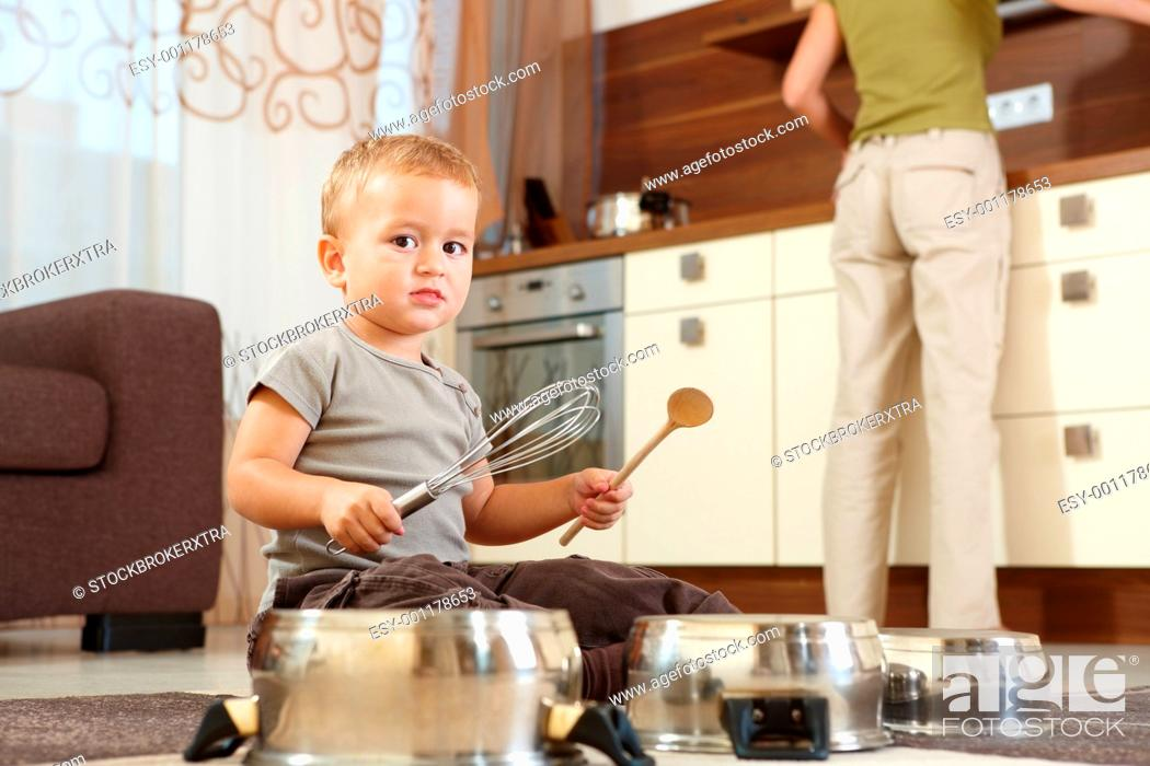 Stock Photo: Little boy playing in kitchen.