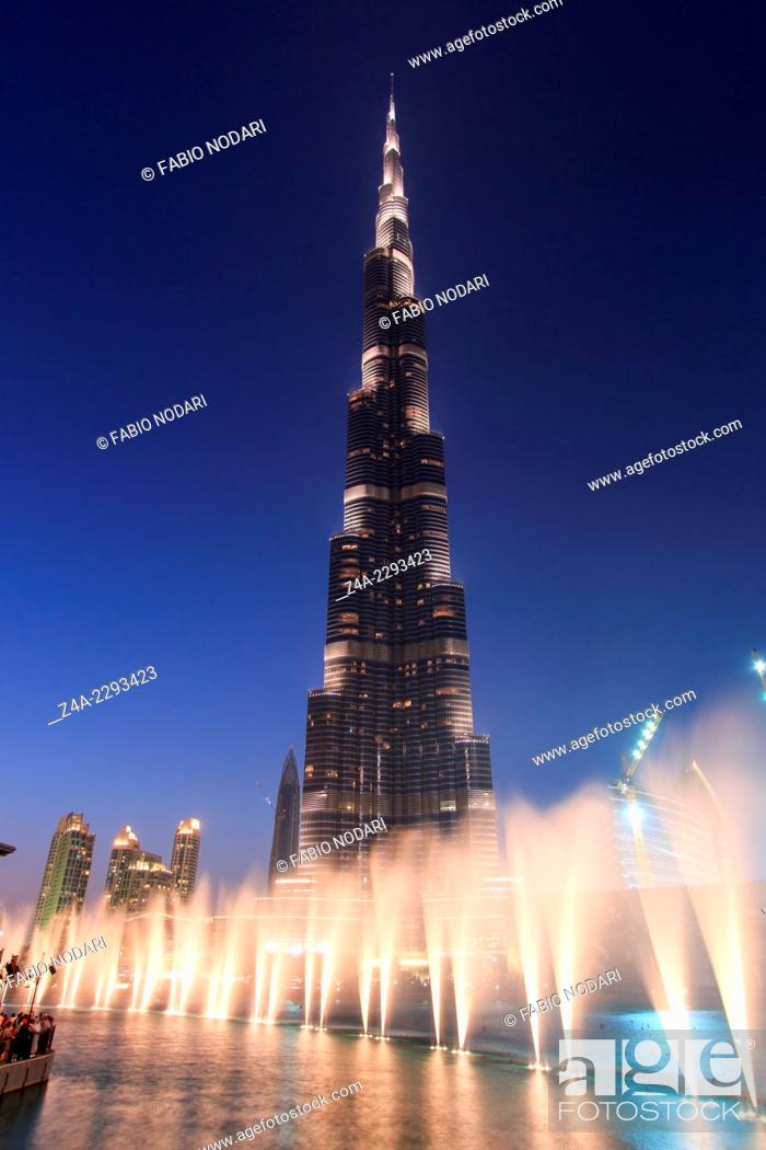 Stock Photo: One of the world biggest musical fountain, in front of the Burj Khalifa, display just after sunset.