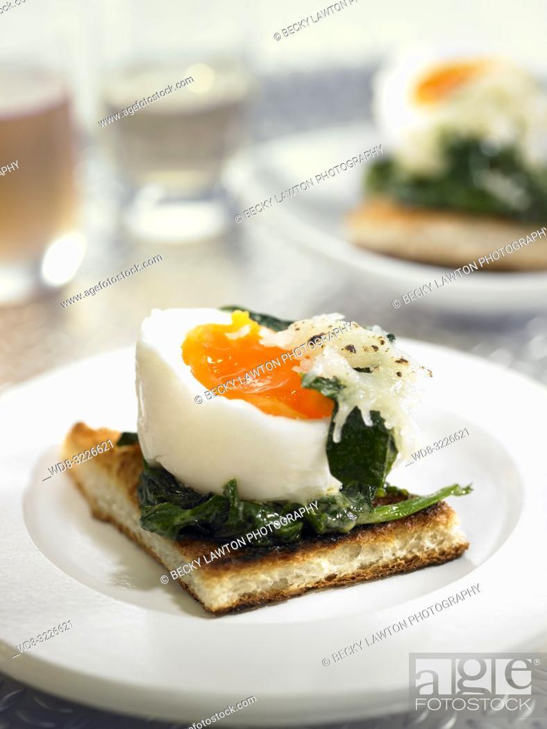 Stock Photo: montadito de huevo mollet con espinacas y jamon / mollet egg montadito with spinach and ham.