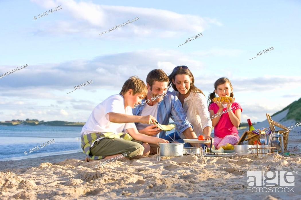 Stock Photo: Family having picnic on beach.